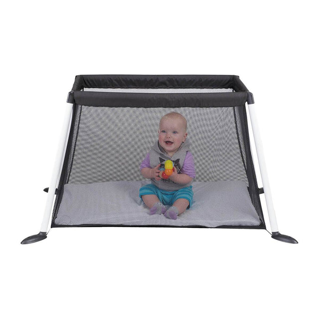 phil&teds traveller travel cot with mesh sides and baby playing inside side view_black