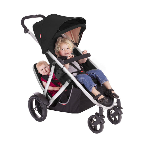 phil&teds verve buggy with double kit in black with 2 toddlers seated 3/4 view_black