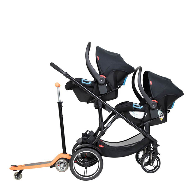 phil&teds voyager inline buggy with double alpha travel system and freerider stroller board at the back