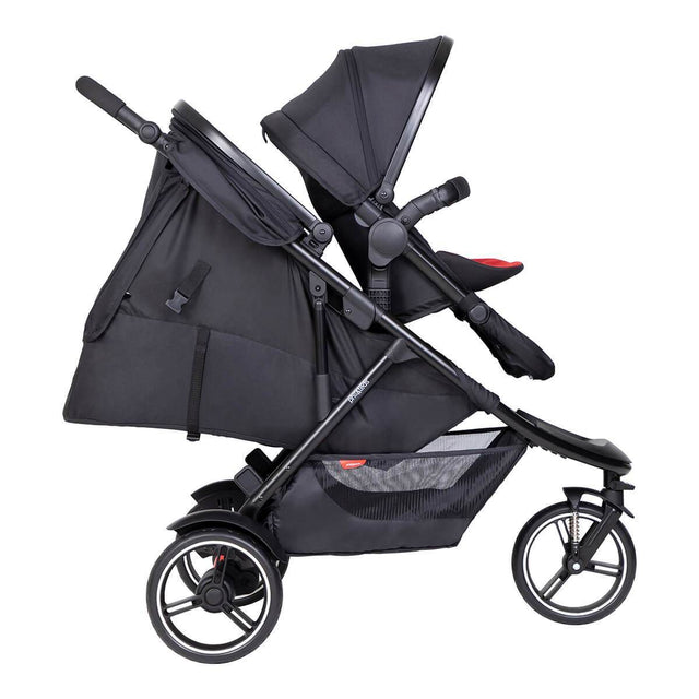 phil&teds dot inline buggy with double kit in front and sling seat in lie flat for newborn