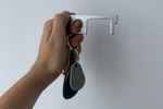 Load image into Gallery viewer, A hand holds a hands free keychain on a key ring.
