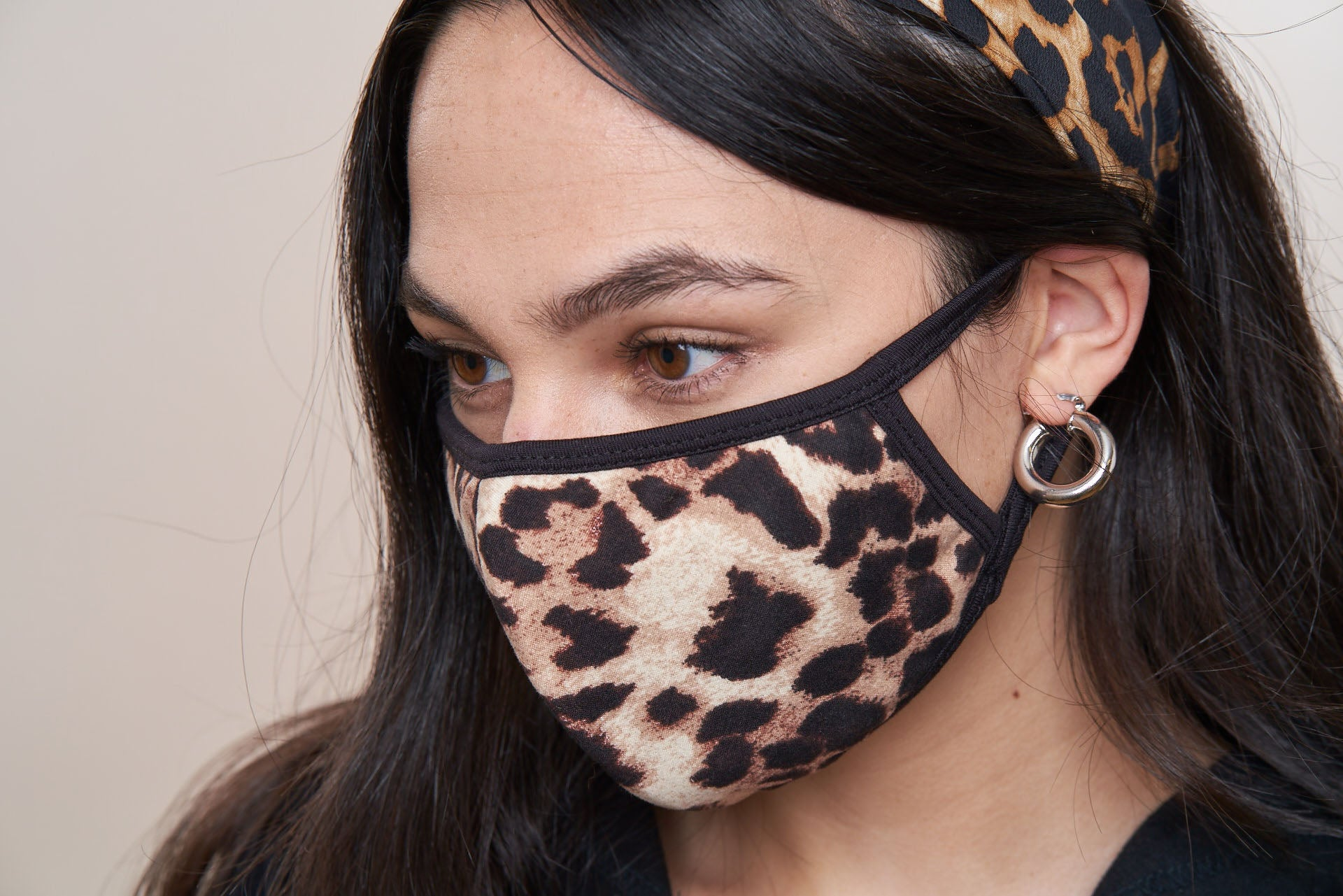 Close up of leopard print face mask with black trim.