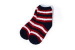 Load image into Gallery viewer, A pair of navy fuzzy socks with thick red and white stripes.