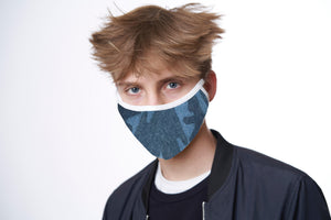 A young man wears a blue camo face mask with white trim.