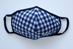 Face mask with a blue gingham pattern and black trim.