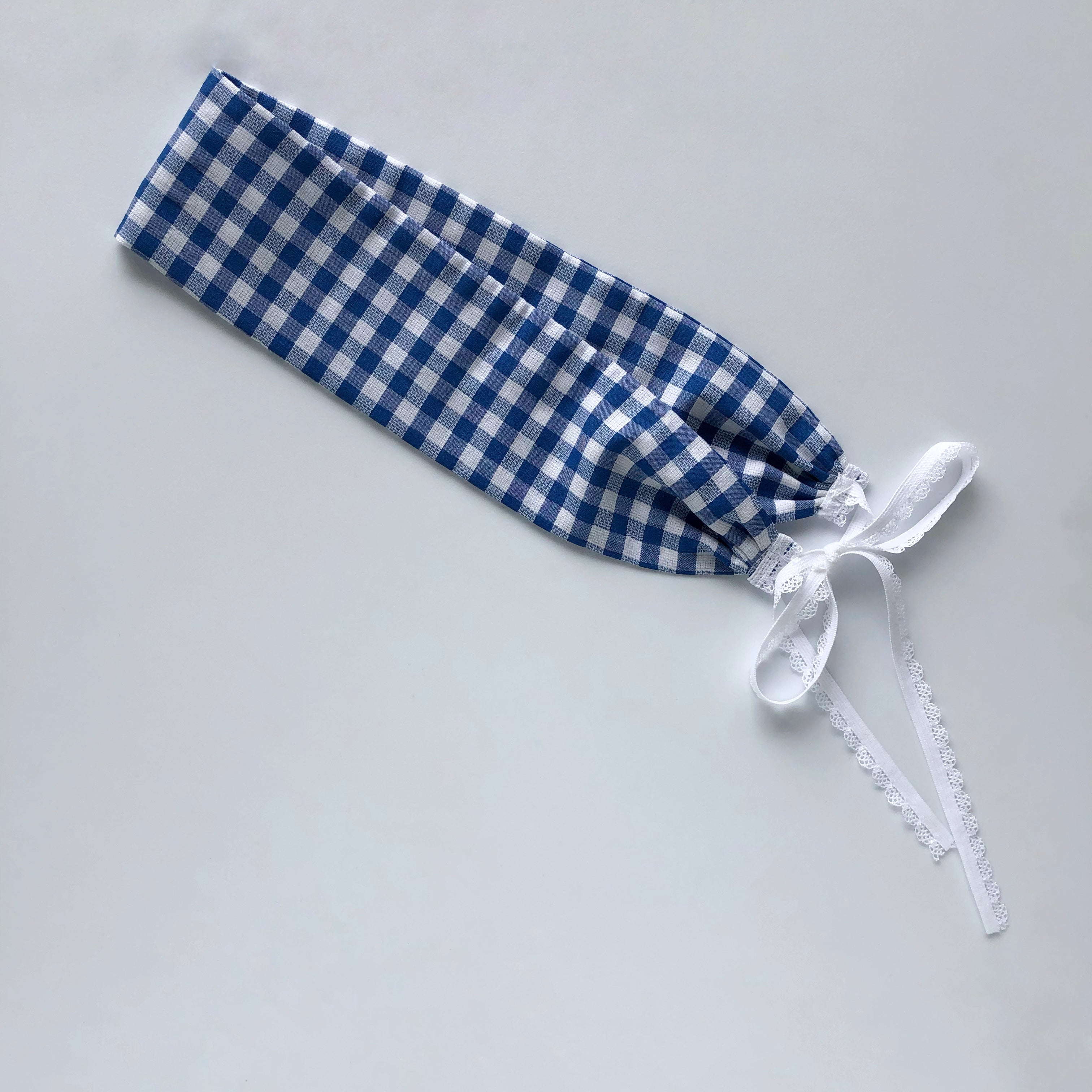 Blue gingham headband with white elastic ties