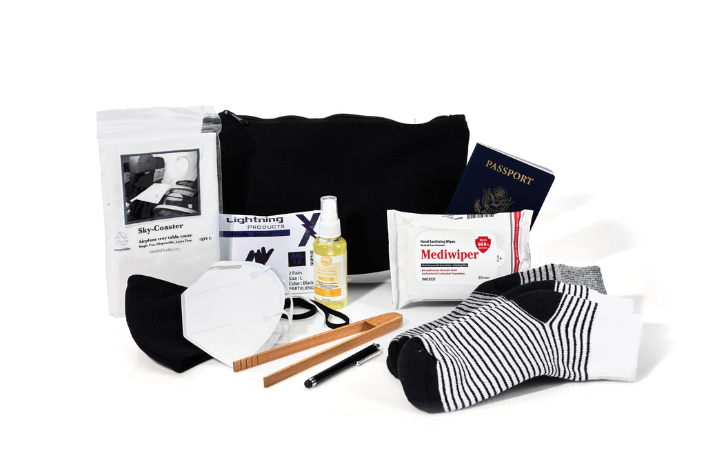 Large zipper pouch, a disposable airplane tray table cover, 2 pairs of disposable nitrile gloves, hand sanitizer spray, a pack of hand sanitizing wipes, a face mask, a KN95 face mask, bamboo tongs, a touch screen stylus, and two paris of striped socks.
