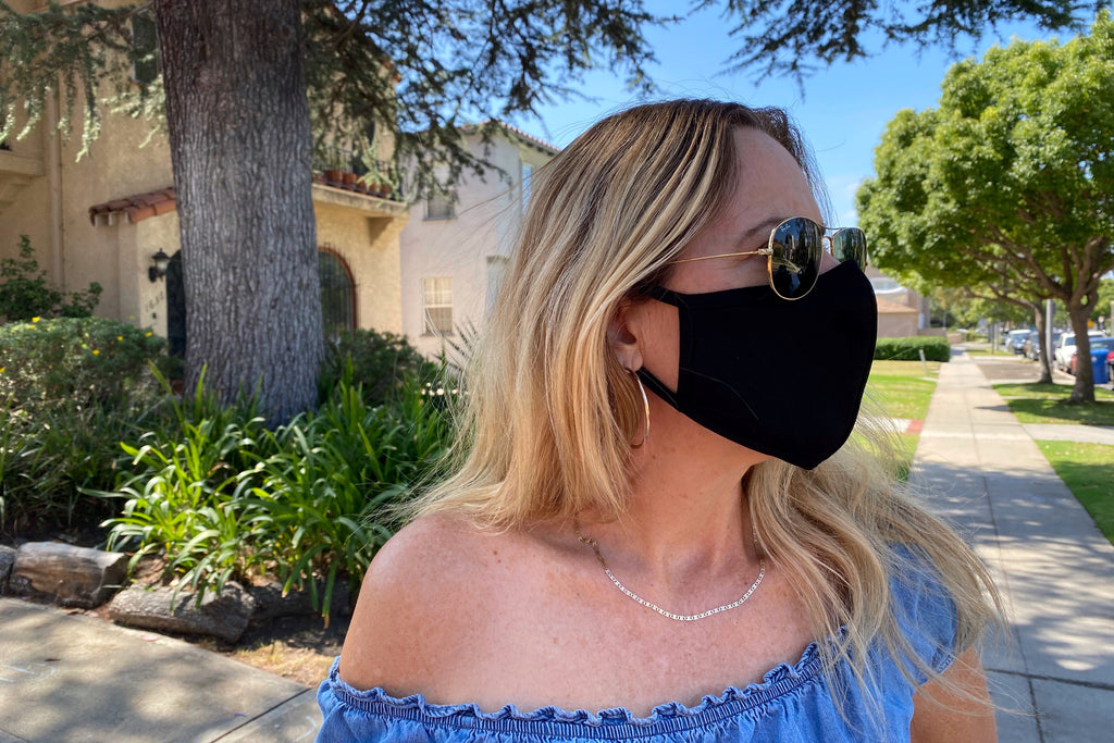 Woman wears the Star face mask that features a nose wire.