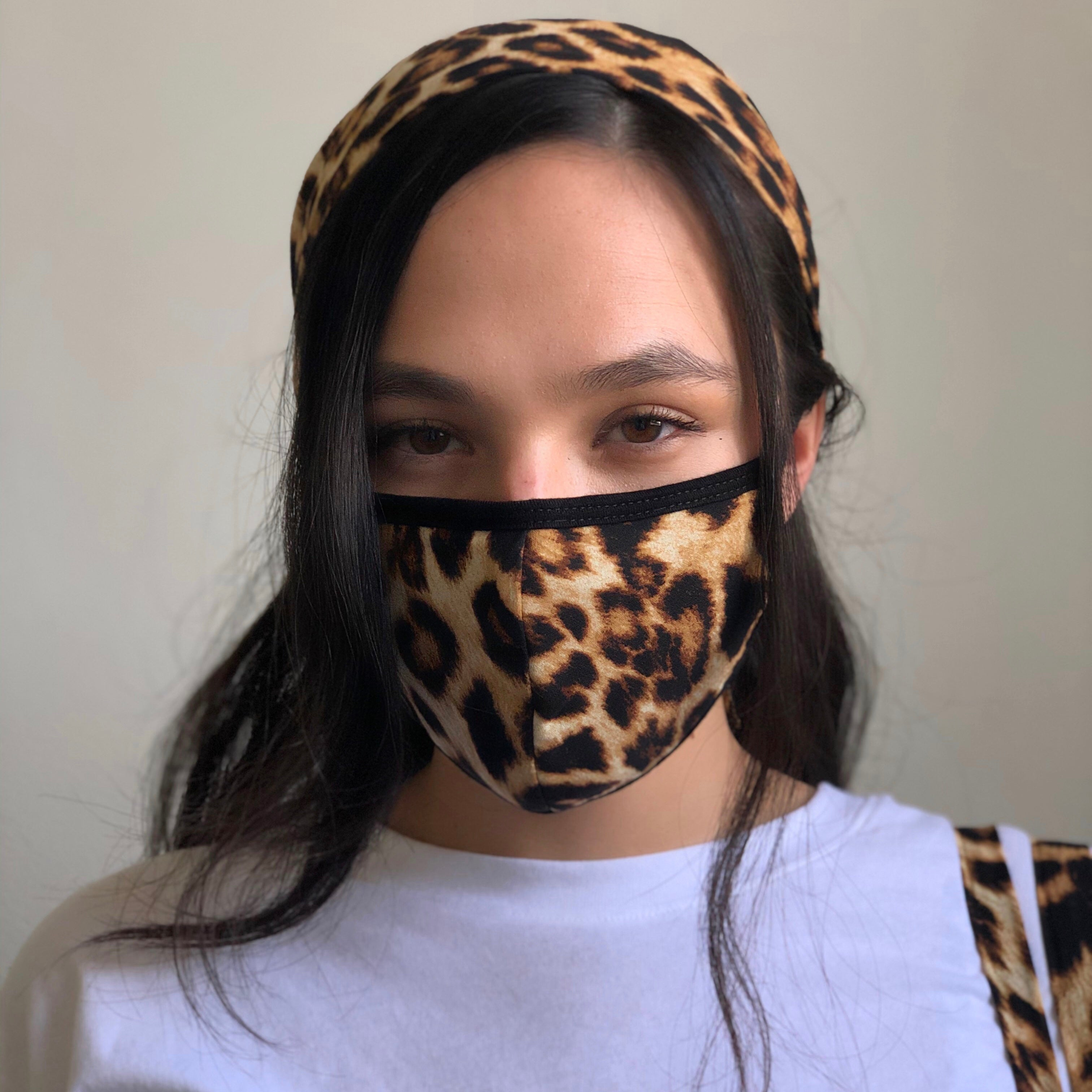 Close up of leopard print face mask and matching scarf.