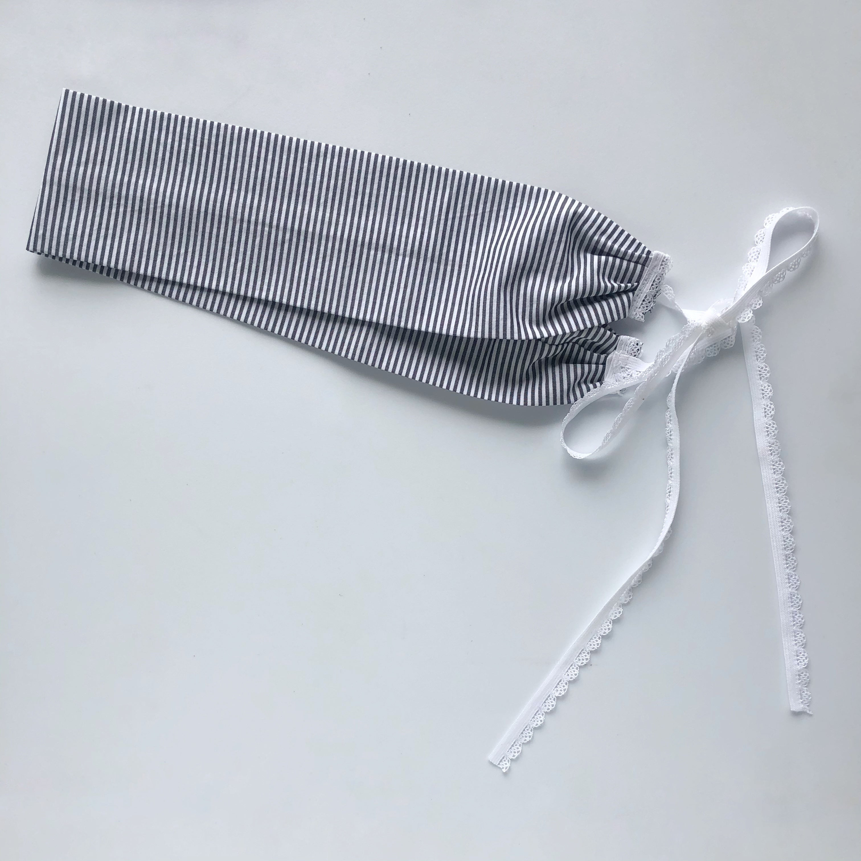 Navy stripe headband with white elastic ties.