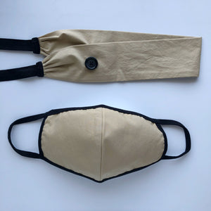 Sand colored headband with black elastic ties and a button to secure your face mask to and a matching face mask.