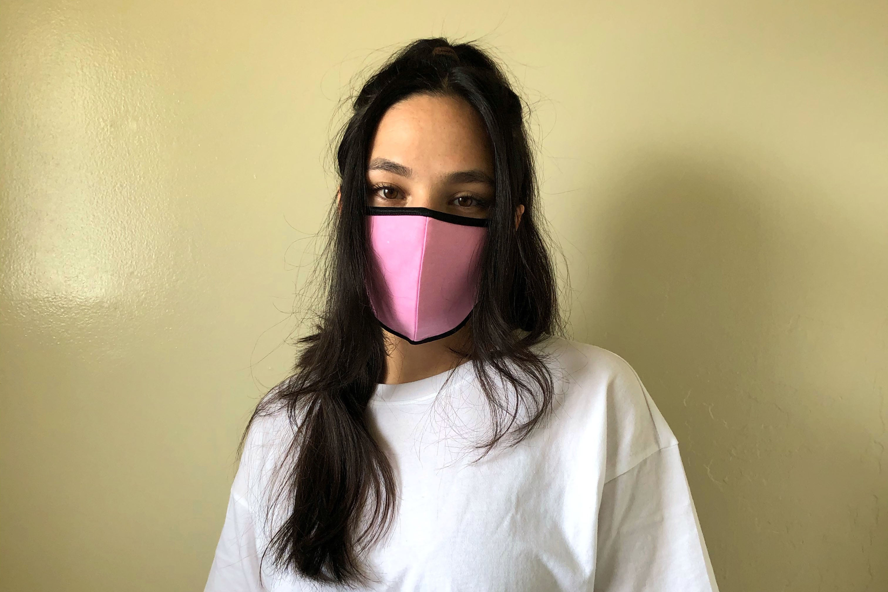 Woman wearing the scout mask in pink.