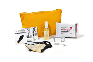 The MB Roadtrip Kit shown here, which includes: arge zipper pouch, 2 pairs of disposable nitrile gloves, hand sanitizer spray, a pack of hand sanitizing wipes, two hands free keychains, and two face masks.