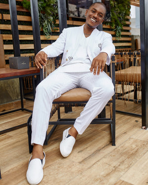 Actor Timini in an all white kochHouse suit
