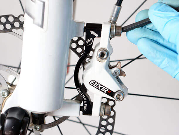 removing avid elixir brake caliper from fork frame