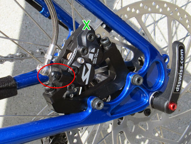 Shimano Saint caliper mounted between chain stay and seat stay