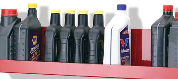brake fluid bottles on red shelf