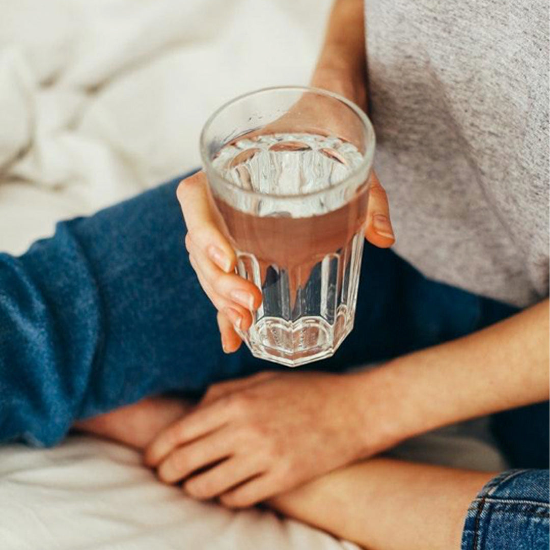 Man holding a glass of water healthy lifestyle