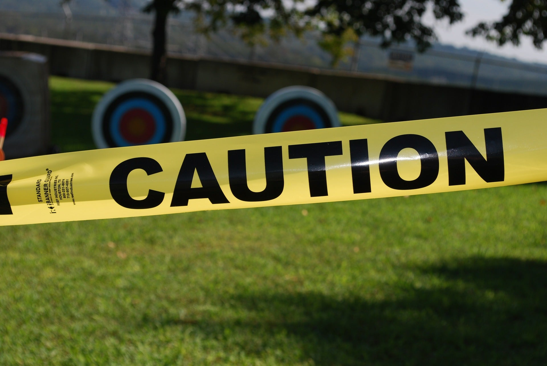 Caution tape, representing the caution issued against a pharmacist for an error by an employee