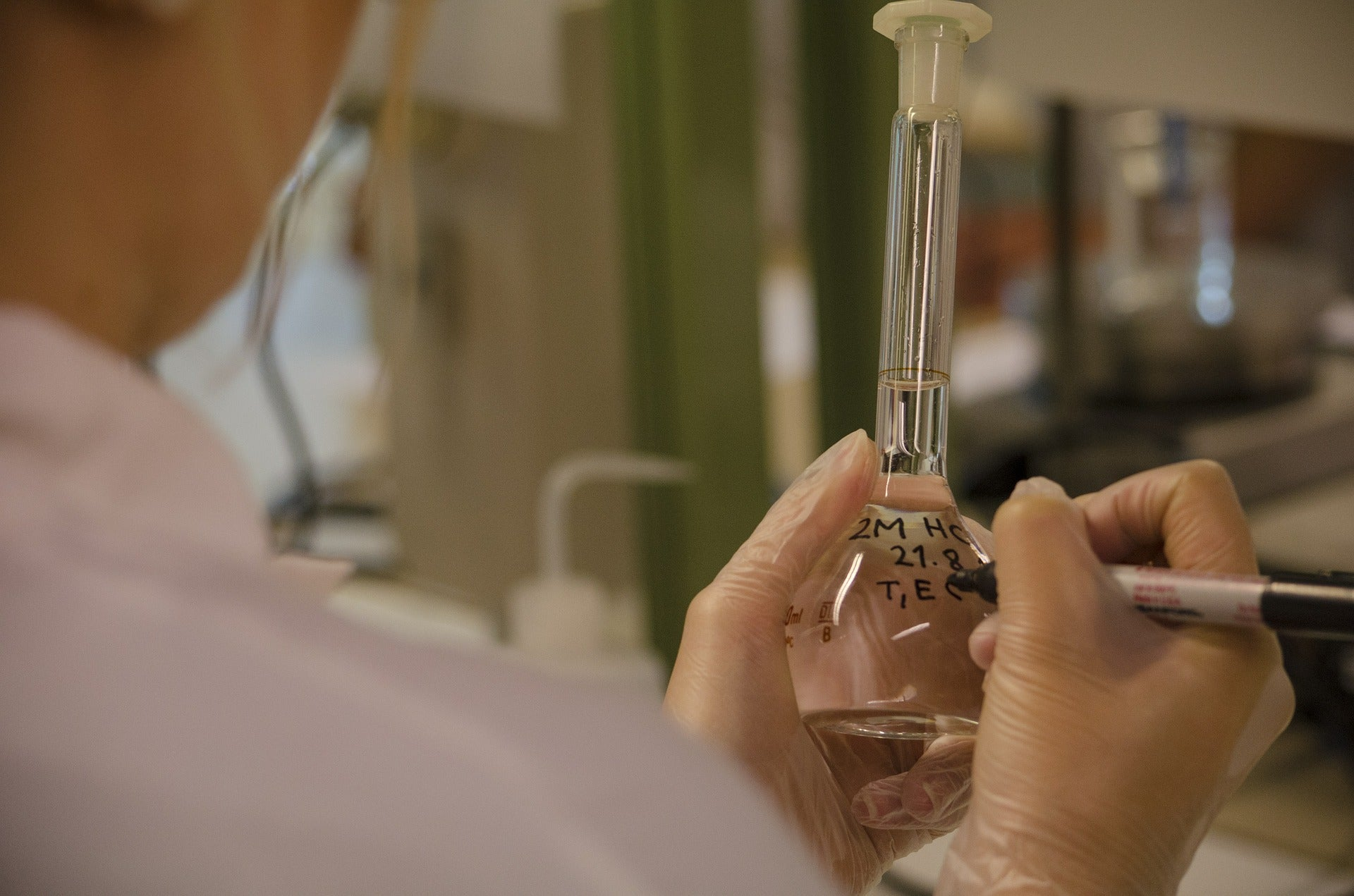 a person in a medical lab labelling a vial for in vitro fertilization