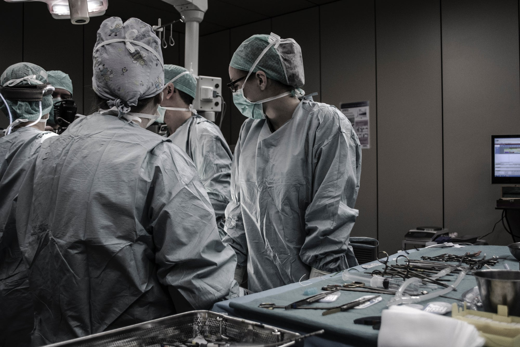 A team of medical professionals overseeing a surgery