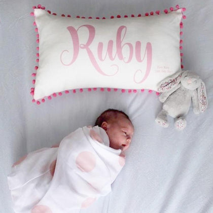 Gorgeous baby cushion with Ruby and pom poms. Off white linen cushion.