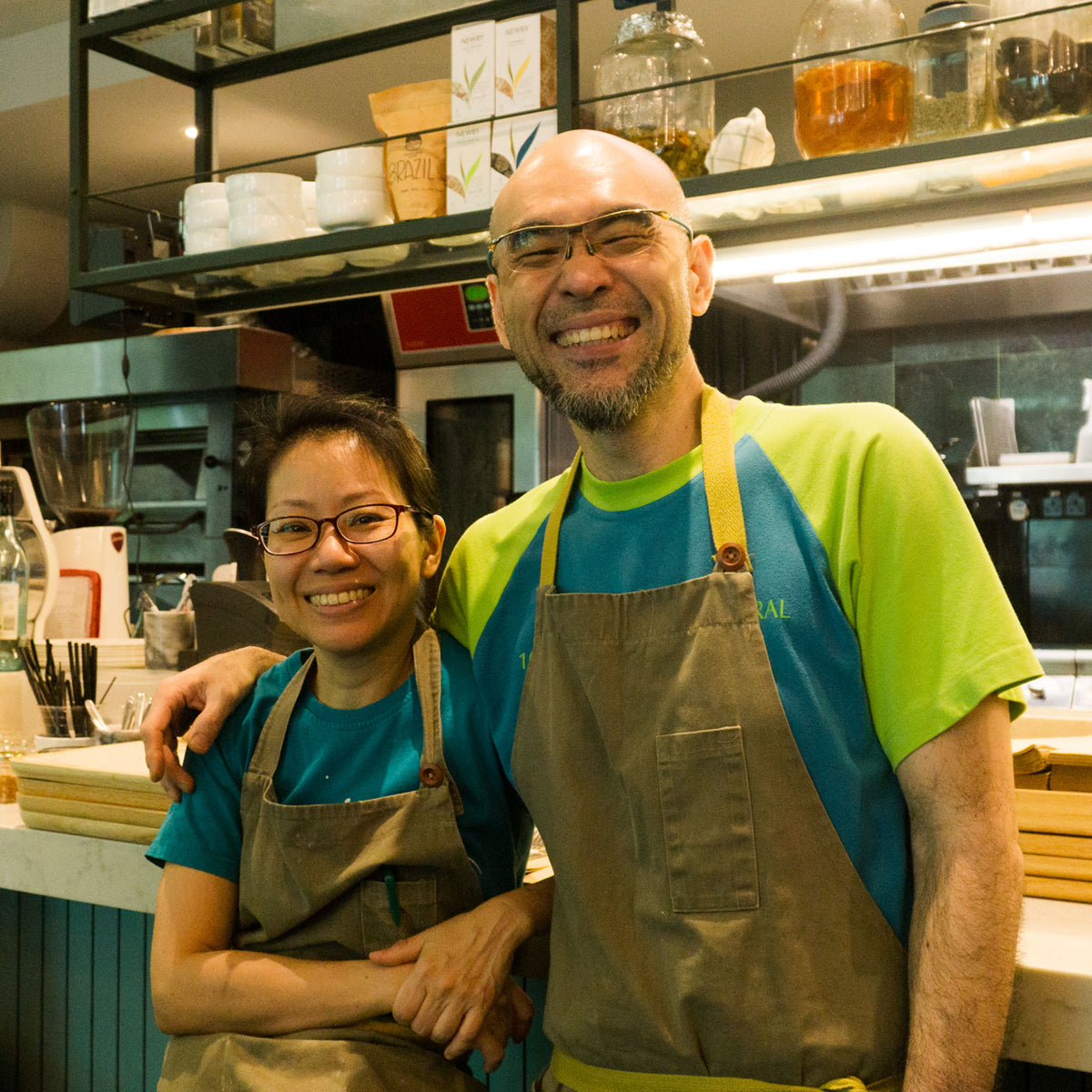 Married couple, Don Lowe and Yen Su Ching, founders and owners of Löwe'f Artisanal, smiling broadly and filled with joy.