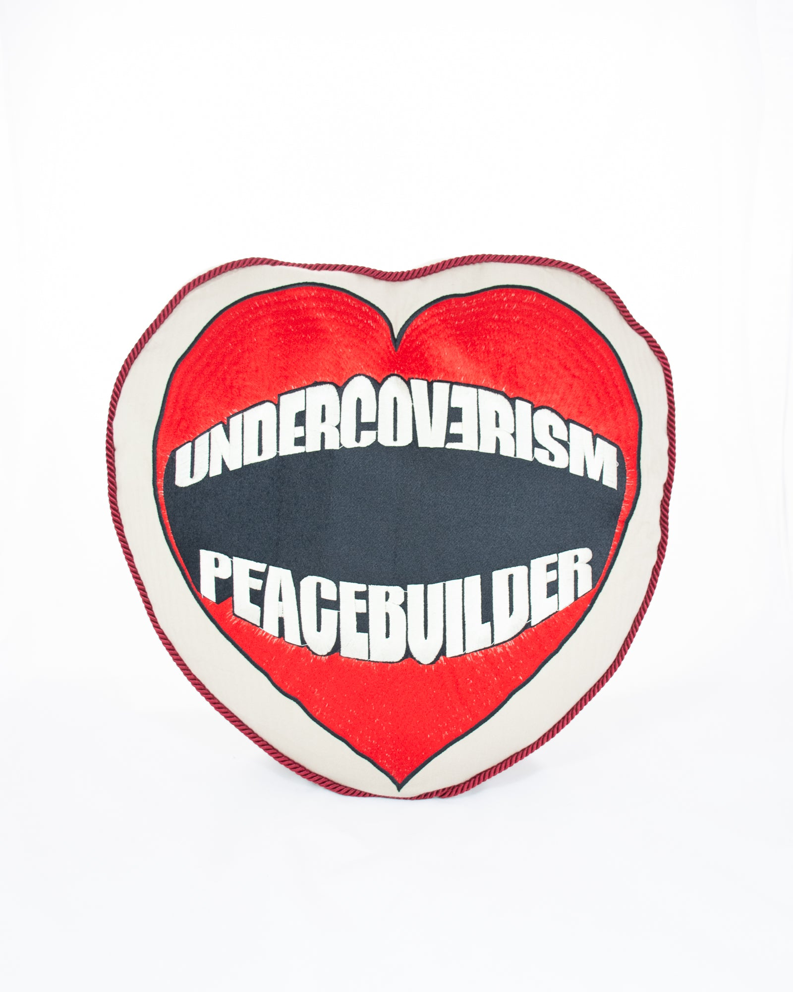LIMITED EDITION UNDERCOVER PEACEBUILDER CUSHION