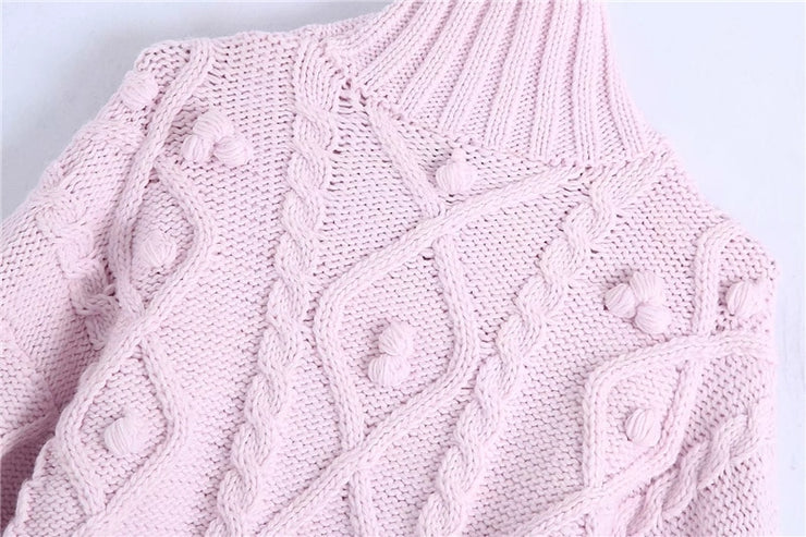 KNIT SWEATER WITH POMPOMS