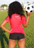 One Flag Nation™ Haitian Pride Black and Red Official Sport Jersey Back View of  Woman Standing with Soccer Ball