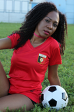 One Flag Nation™ Haitian Pride Black and Red Official Sport Jersey Woman Sitting with Soccer Ball 2
