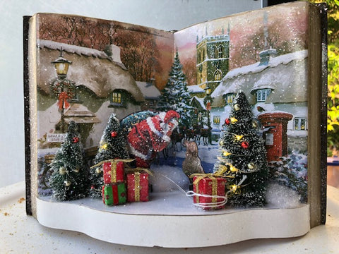 Christmas Village Courtyard Scene with Santa in Open Decorative Book
