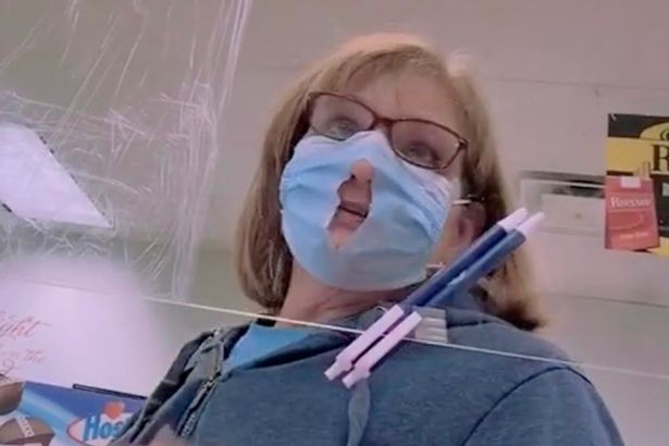 Woman Cuts Hole In Face Mask Making It Easier to Breathe