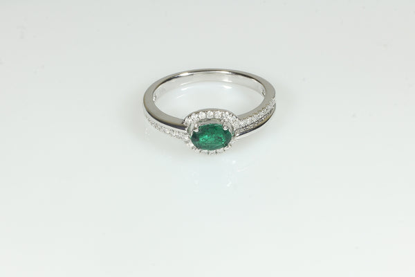 Centered Emerald and Diamond Ring