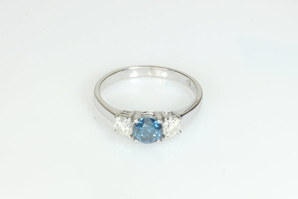 Blue Diamond with Two White Diamond Ring