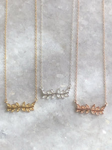 Fancy Leaves Necklace: available in silver, gold, and rose gold.