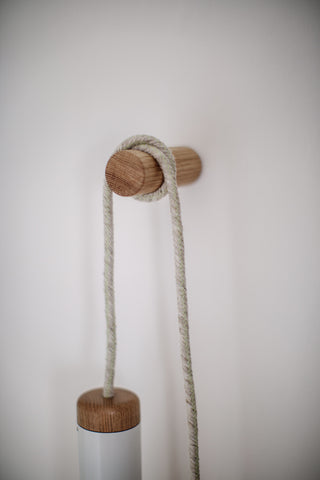 detail of linen flex chord wrapped around oak dowel