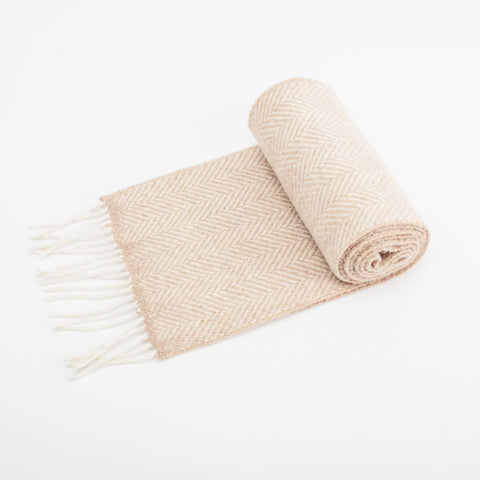 95% Merino wool and 5% Cashmere herringbone scarf in fawn with fringing detail woven in Ireland