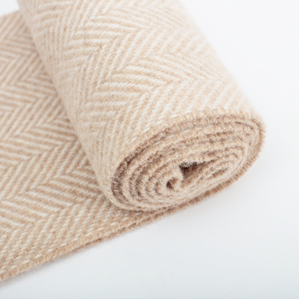 detail of wool mix herringbone scarf in fawn by family weavers John Hanly made in Ireland data-zoom=