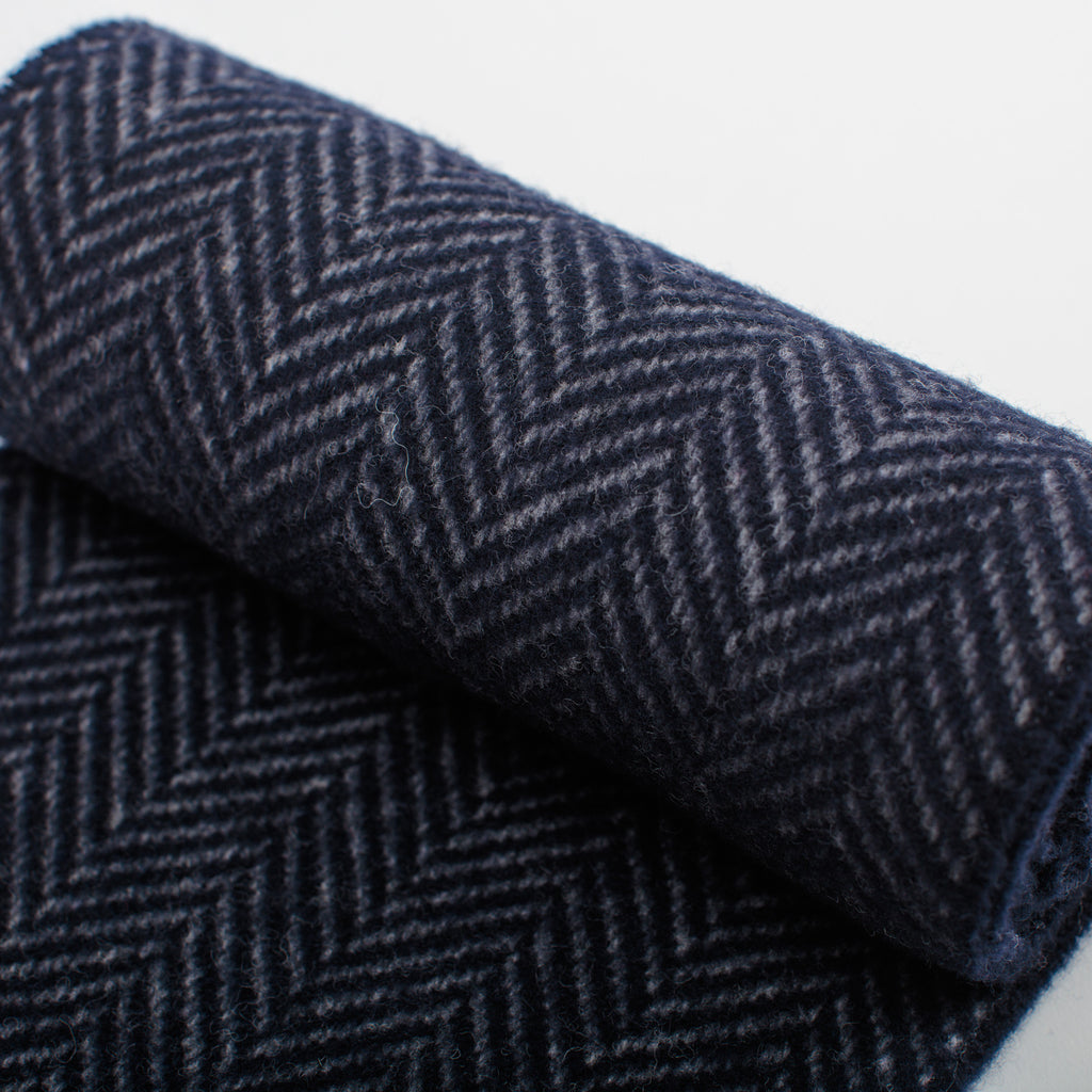 detail of navy blue cashmere merino herringbone unisex scarf woven in Ireland   data-zoom=