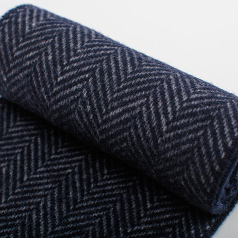 detail of navy blue cashmere merino herringbone unisex scarf woven in Ireland