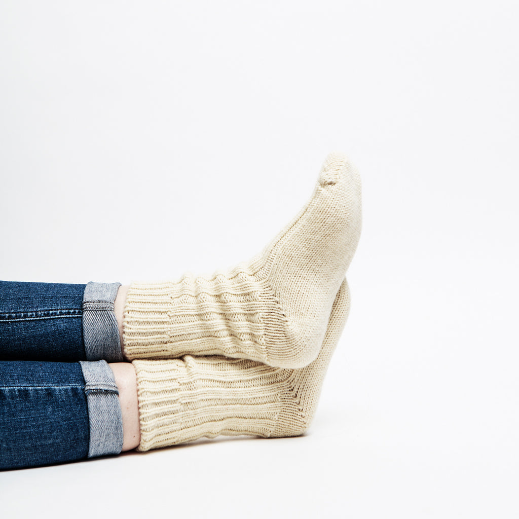 model wears 100% pure organic wool socks by Kerry woollen mills perfect for hiking and lounging