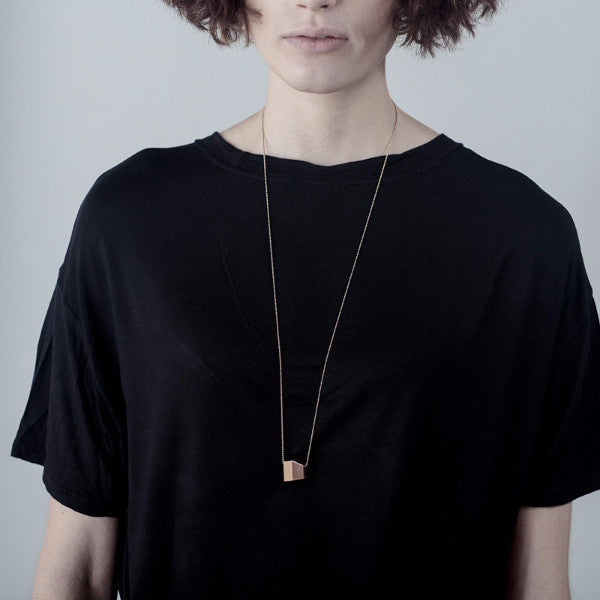 Model shot Clare Necklace, 18ct Rose gold plated geometric pendant, ball chain, mirrored and brushed surfaces.   data-zoom=
