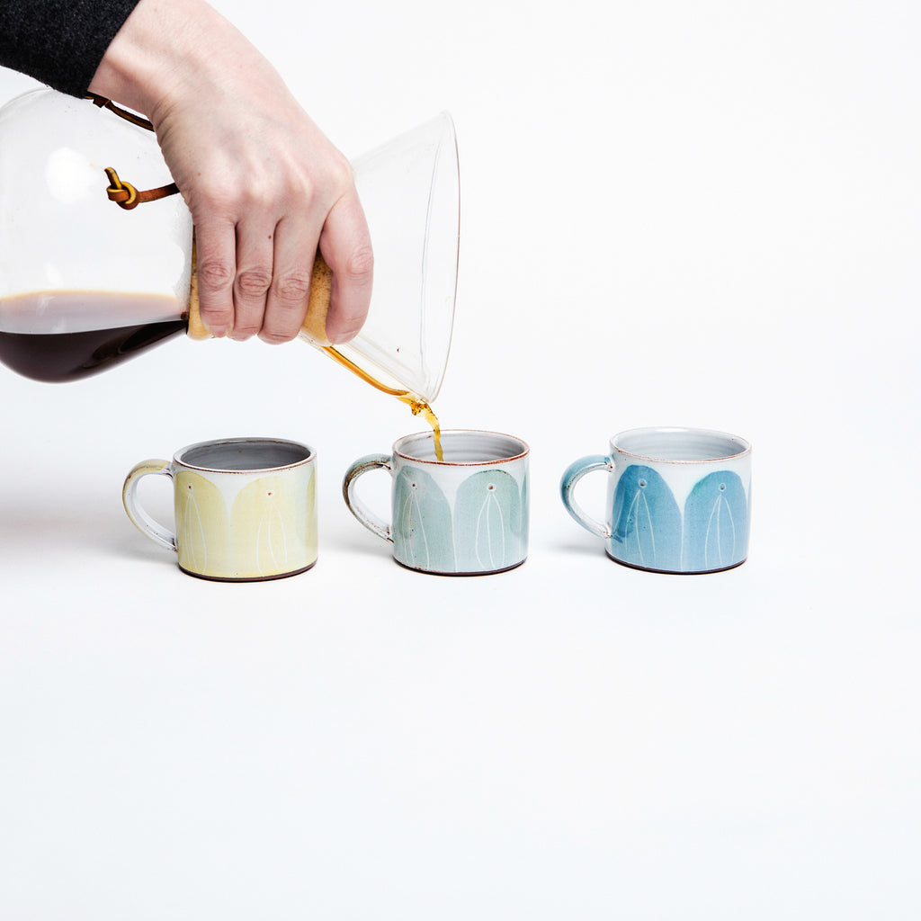 Espresso cups made in Ireland by master potter Caroline Dolan, beautiful hand glazed espresso cups, available in yellow, teal and blue arches, comfortable cups to hold. Great house warming gifts for coffee and ceramic lovers... data-zoom=