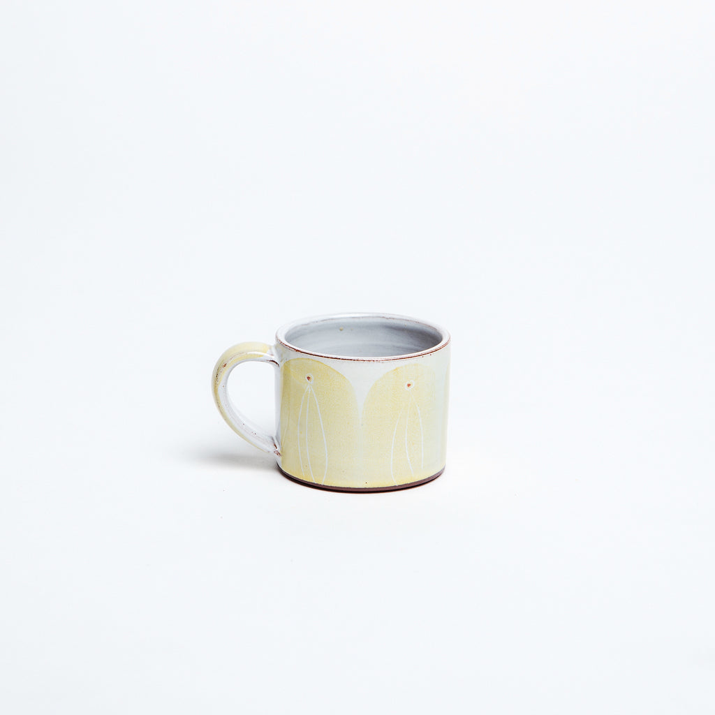 Yellow espresso cup, white inside glaze with yellow painted arches, made in Kilkenny. data-zoom=