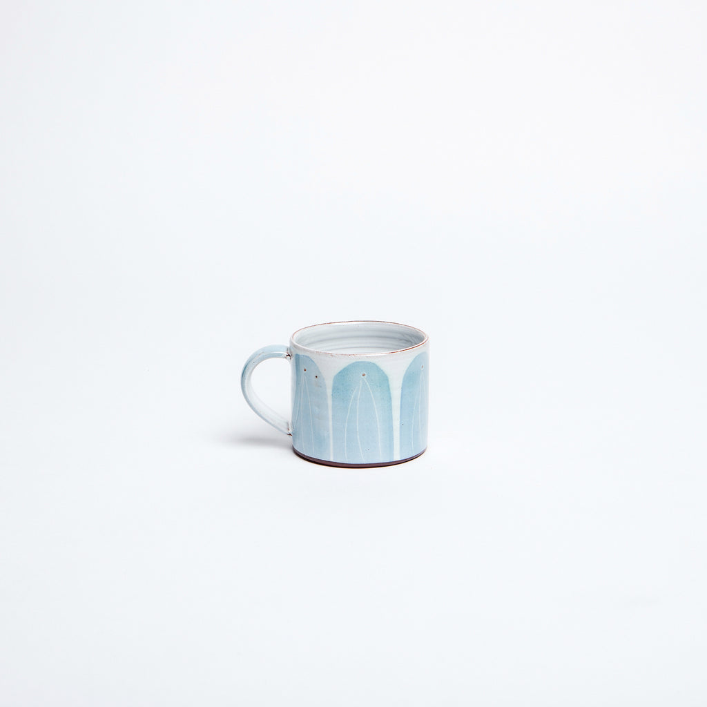Irish blue hand made mug, by Kilkenny potter Caroline Dolan, subtle blue arches on white glaze, achieving the perfect cup of tea. data-zoom=