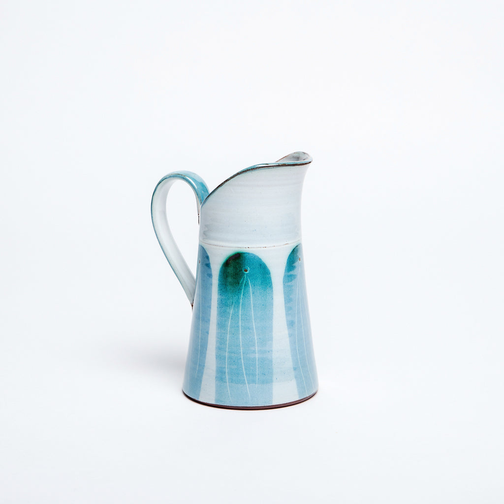 Modern interpretation of traditional irish tin jug with beautiful blue arches glaze data-zoom=