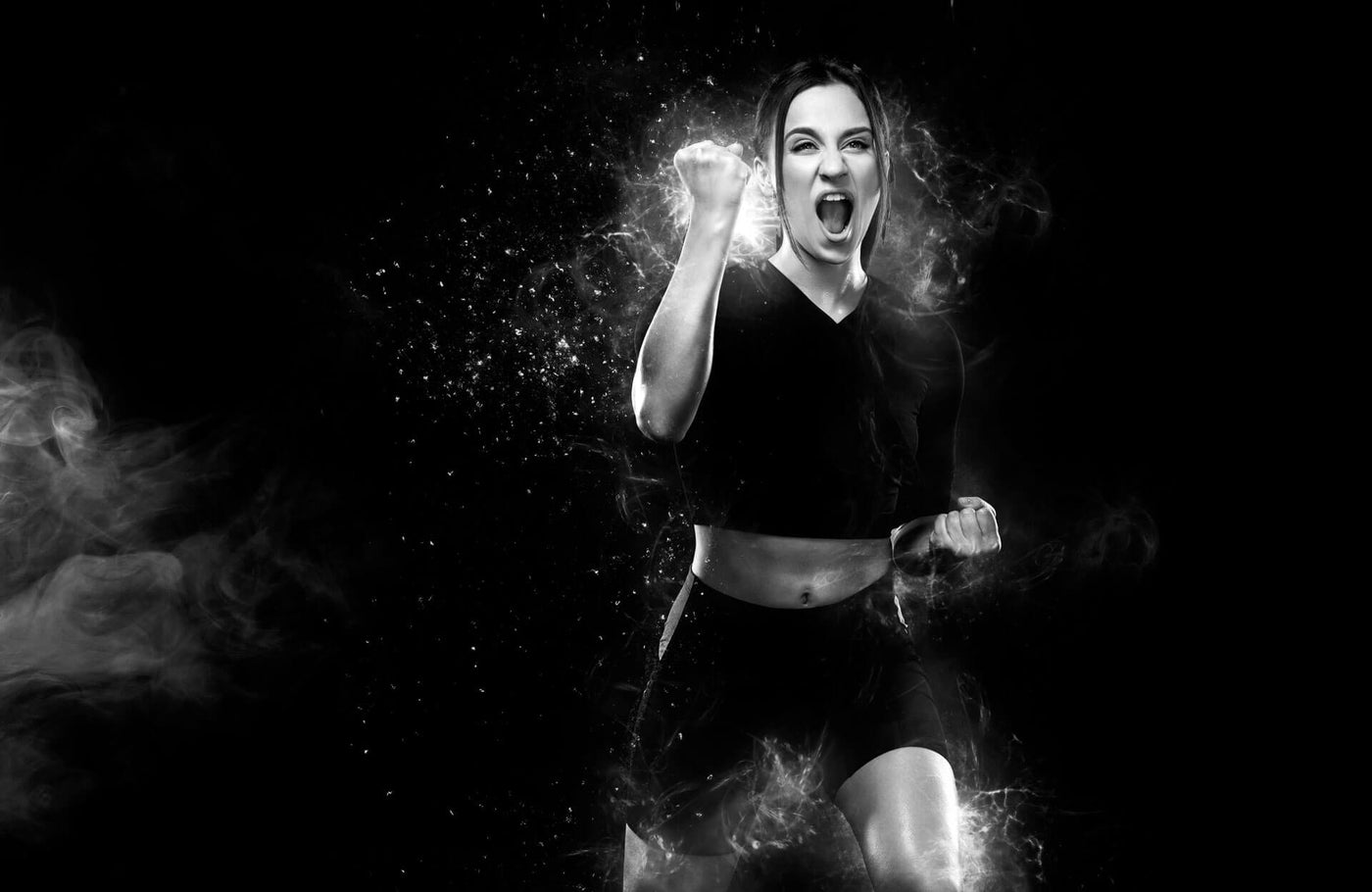 Fitness and sport motivation.. Strong and fit athletic, woman sprinter or runner, running on black background in the fire wearing sportswear.