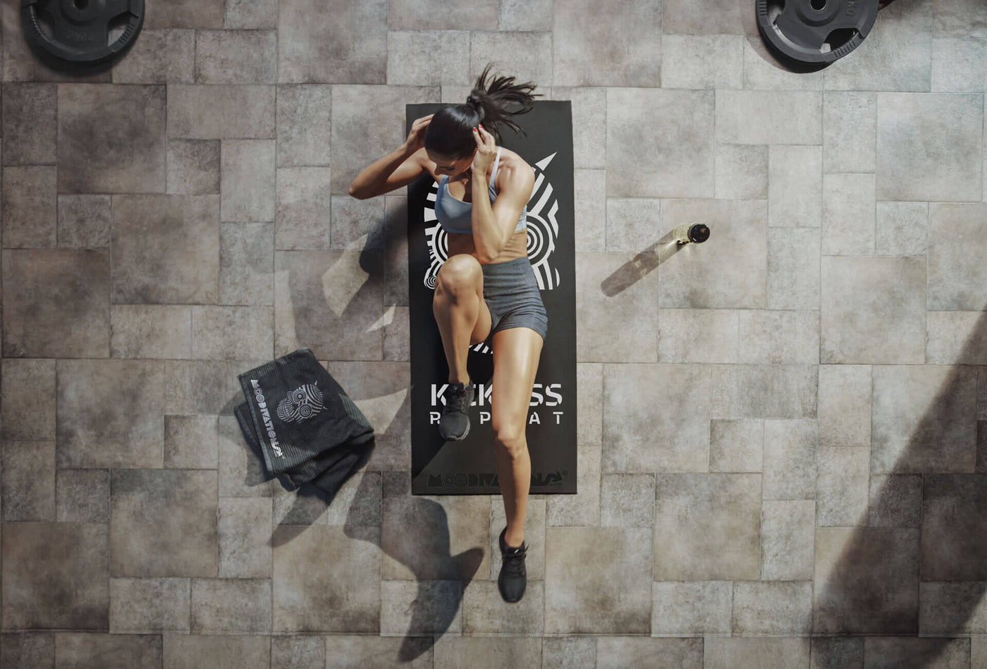 Top View Shot of  Female Athlete Doing Bicycle Crunches while Lying on the Workout Mat