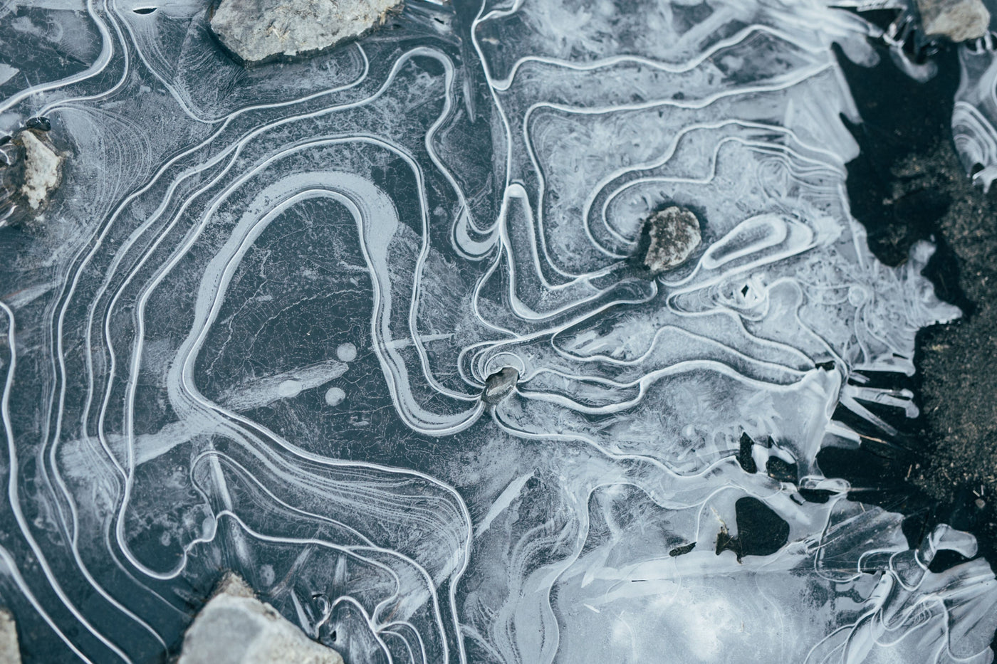Aerial photography of lines in frozen water
